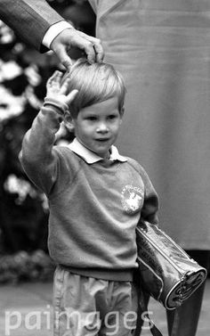 Prince Harry , the three-year-old son of the Prince and Princess of Wales, arrives for his first day of nursery school at Chepstow Villas in west London with a Thomas the Tank Engine bag.