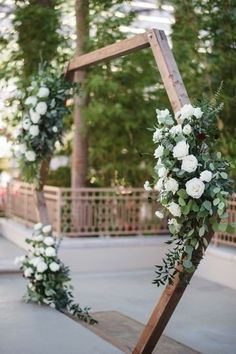 Geometric wedding ceremony backdrop idea - wooden backdrop with greenery and whi. Geometric wedding ceremony backdrop idea - wooden backdrop with greenery and white flower arrangements {With Love by Tar. Wedding Altars, Wedding Ceremony Decorations, Wedding Centerpieces, Church Decorations, Wedding Ceremonies, Geometric Wedding, Floral Wedding, Wedding Flowers, Wedding Flower Backdrop