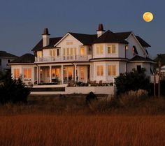 South Carolina beach house at night during a full moon. Enjoy the porch and deck and witness how Southerners live inside and outside of their homes.