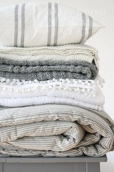Layered grey, cream and white linens for all seasons in varied textures - Love