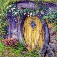 "Yellow hobbit door in the Hobbiton ""subdivision"" built specifically for filming of The Hobbit."