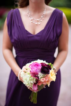 Purple bridesmaid's dress at a glamorous wedding. | Photo by tessamarie.com