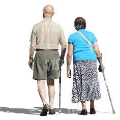 An elderly man and woman walking with walking sticks