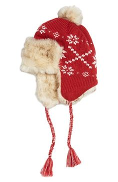 A fluffy pompom tops a color-pop knit beanie lined with cozy faux-fur fleece that helps to block cool breezes. Tasseled, braided ties swing from the ear flaps for a cute, retro look. PJ SALVAGE