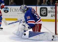New York Rangers goalie Henrik Lundqvist (30) makes a save against the New Jersey Devils in the third period of an NHL hockey game Monday, Feb. 8, 2016, in New York. The Rangers defeated the Devils 2-1. (AP Photo/Adam Hunger)