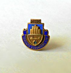 Toronto Elevators Pin 10 Years Service marked BIRKS yellow Gold and Blue Enamel bF 10 Years, Cool Stuff, Stuff To Buy, Yellow, Blue, Toronto, Enamel, Handmade, Vintage