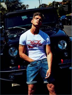 Model Austin Victoria rocks a Christopher Shannon t-shirt with GUESS denim shorts.