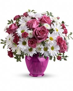 nice Pink Daisy Delight Fresh and fabulous, this stylish blend of white daisies and pink roses in a fuchsia ginger jar will brighten any occasion.The striking contemporary vase will be enjoyed for years.