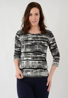 TO20060 Black and white print top round neck 3/4 sleeve. This top is a great every day piece that will go with just about anything. Pair with our embroidered pocket trousers dressed up with heels or dressed down with pumps. Approx. 63cm. 95% Polyester 5% Elastane. Machine washable.