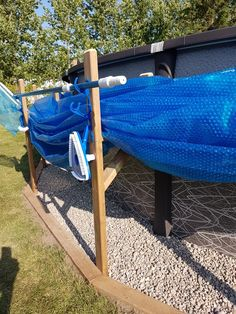 Pool cover and tool holders Pool Cover Roller, Above Ground Pool Cover, Solar Pool Cover, Pool Deck Plans, Pool Storage, Outside Pool, Diy Pool, Pool Fun, Above Ground Pool Landscaping