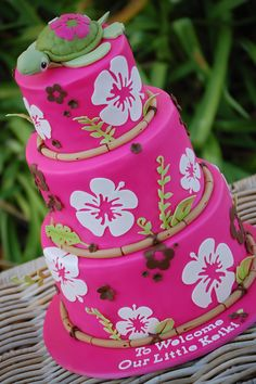 Hot Pink Hibiscus - A hibiscus cake with bamboo border. I used my new Cricut cake to cut out the hibiscus and the leaves using gumpaste. The fondant colour is Fondarific Hot Pink with extra Wilton Rose added for a deeper colour. The turtle topper is fondant-covered RKT with a gumpaste head. Thank you for looking