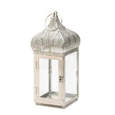 The captivating design of Morocco will add some international flair to your candle with this exotic dome lantern. Clear glass panels let the light shine through, topped with an ornate domed roof and o