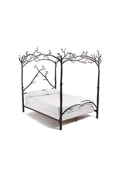 Love this forest themed four poster bed
