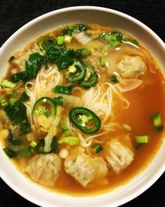 Faux Pho with Wontons / serves 2  Prepare 1 packet of Trader Joe's Fresh Rice Noodles according to directions. Drain & rinse.   Warm 1 Tbsp sesame oil in a saucepan over medium-high heat. Sauté 1 tsp minced garlic & 1 tsp minced fresh ginger until fragrant. Add 4 Tbsp soy sauce.   Pour in 2 cups chicken broth & 2 cups water. Bring to a boil.   Add 16 TJ's mini chicken & cilantro wontons, 1 cup chopped Napa cabbage, 1 cup chopped bok choy, & 2 sliced scallions. Cook for 2 min. Serve over…