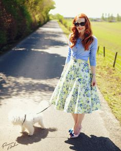 Circle skirt with cardigan, I like how she has the cardigan knotted at the bottom