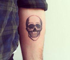 skull tattoo via Tattoologist