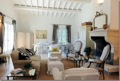 seagrass rug, roll arm sofa, slipcovered chairs, arm chairs
