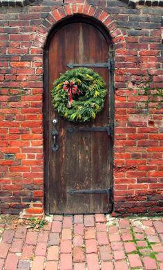 Love both the wooden door and brick combination.