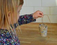 How to make your own fat ball bird feeders - a lovely activity to do with children.