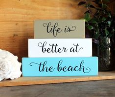 Life is Better at the Beach Set of 3 wood blocks. 6 3/4 h x 9 w x 1 1/4 deep inches. On a painted worn finish with black lettering. Tuck on a shelf, sit on a desk or table. A wonderful addition to your beach cottage.