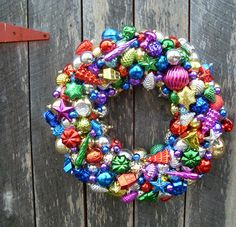 I made one of these using all these great old Shiny Brite ornaments. I hung it outside on my front door, not really thinking... opened my door the next morning and EVERY SINGLE ornament had come unglued and was broken into a million pieces!