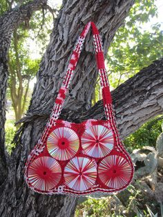 """CD and Pop Top Tab Purse 11"""" tall, 11.5"""" wide, 16"""" wide at base, lined with red fabric, strap measures 33"""" long and 3"""" wide."""