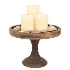 Warmly weathered wood pedestal.  Product: TrayConstruction Material: WoodColor: Natural...