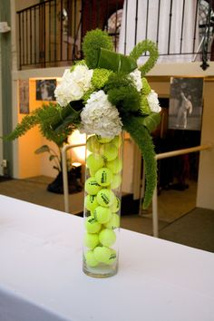 sports centerpiece. large vases each filled with different kinds of balls (golf, ping pong, tennis, golf tees, baseballs, mini footballs, basketballs.