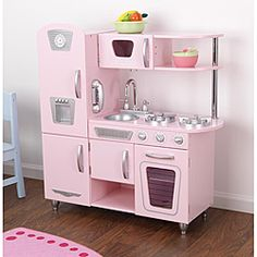 Little chefs will love cooking up fun with the adorable Kid Kraft Pink Vintage Kitchen play set. This play kitchen has doors that open and close, knobs that click and turn and lots of convenient stora Kitchen Buffet, Toy Kitchen, Kitchen Sets, Kitchen White, Kitchen Appliances, Play Kitchens, Kidkraft Kitchen, Play Houses, Vintage Pink