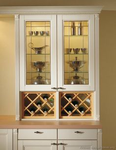 kitchen idea of the day: beautiful glass display cabinet with wine