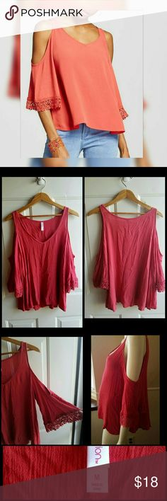 """Bell Sleeve Cold Shoulder Top Color Terracotta Pink. Deep cold shoulder cut for flirty exposure. Fringe trimmed bell sleeve for add light grace. Loose fit has all day comfort and swing movement. Never worn, new with no tags.   Measurements:  Medium = 7/9 Bust 34.5"""" - 35.5"""" Waist 28.5"""" - 29.5""""  Inseam length 14.25""""   Get an additional 30% off with the purchase of 3 or more items using the bundle feature. Always welcome offers.  Tops"""