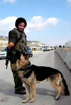 Oketz Soldier Feeds Her Dog Hanukkah Treats, via Flickr.