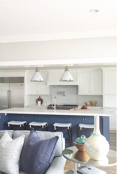 Farrow and Ball Stiffkey Blue. The kitchen island color is Farrow and Ball…