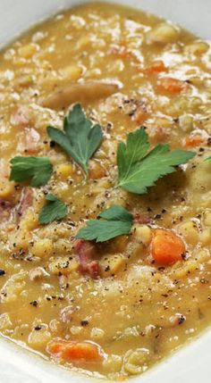 Ham and Split Pea Soup: canola oil 1 large onion, chopped 2 celery stalks, chopped 2 carrots, chopped 1 meaty ham bone 3 cups dry green or yellow dried split peas a handful (a cup or two) small red or yellow-skinned potatoes, quartered a few sprigs of thyme 8 cups chicken stock black pepper In a large pot, heat a generous drizzle of oil and saute the onion, celery and carrots. Add the ham bone, split peas, potatoes, thyme and stock and simmer. Cook an hour.