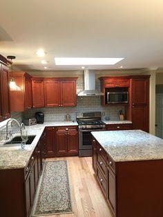 Kitchen Dark Brown Cabinets With White Granite Top Design