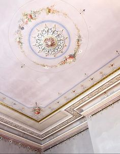 Ceilings are often overlooked- this one certainly wasn't! The rosette, delicate floral painting, crown molding- I love it all.