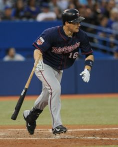 Jun 9, 2014; Toronto, Ontario, CAN; Minnesota Twins left fielder Josh Willingham throws his bat away after hitting a triple in the sixth inning against Toronto Blue Jays at Rogers Centre. Mandatory Credit: Dan Hamilton-USA TODAY Sports