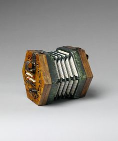 "*1862 British Concertina at the Metropolitan Museum of Art, New York - From the curators' comments: ""A student model with colored buttons to facilitate the orientation of the fingers: the white buttons are for diatonic tones, red is C, the black buttons are the accidentals."""