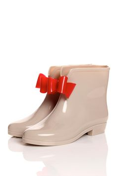 If you don't thins is cute, how dare you? These rain boot are sssoooo cute you probably wouldn't care if it's raining or not your going to wanna wear this. It comes in Beige (red bow), Black (pink bow), Black (beige bow) and Red (black bow). Enjoy! $28
