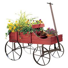 "Showcase flowers & plants and create sensational seasonal displays with our #Amish Country Wagon. Crafted from wood with rolling iron wheels. Measures 44 1/4""L (..."