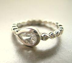 Pear Shape ring.   White sapphire, 14k gold ring.. $850.00, via Etsy.