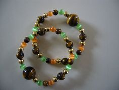 "Motion sickness bracelet set in ""Twinkling Tiger Eye"" for stylish motion sickness relief at http://www.queasybeads.com"
