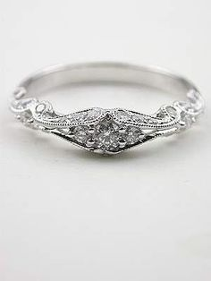 An antique engagement ring very elegant something along the lines of what I would want ;) *hinthint*