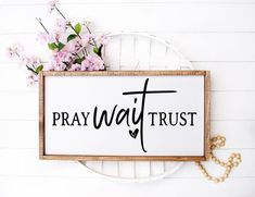 Pray Wait Trust Framed Wood Sign This listing is for the sign only. All other items are for display purposes. Available Sizes: 10H x 20W 12H x 24W 14H x 28W Your choice of White, Black or Gray background and lettering color of Black, Gray or White. Please see listing photos for frame stain color