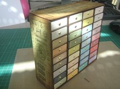 How clever...this lady created a distress ink pad holder using match boxes placed together. Instruction on her blog.