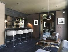 Masculine and Modern Man's Bar/Lounge Area with chrome and leather club bar chairs.