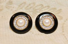 Vintage Designer Inspired Gold Plated Faux Pearl Crystal Dome Earrings is designed with cream white glass cabochons encircled by rhinestones in a gold plated setting.  These earrings are sophisticated
