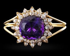 Amethyst and Diamond Bangle Bracelet, 50.00 Carats~ Weighing approximately 50 carats, the cushion-cut amethyst at the center of this bangle bracelet exhibits the deep, evenly distributed purple color found in only the finest examples. Creating a starburst motif around the amethyst are approximately 5 carats of diamonds. 18K yellow gold. ~M.S. Rau Fashion Bracelets, Bangle Bracelets, Bangles, Antique Jewelry, Vintage Jewelry, Antique Bracelets, Amethyst Jewelry, Rare Gemstones, Diamond Bangle