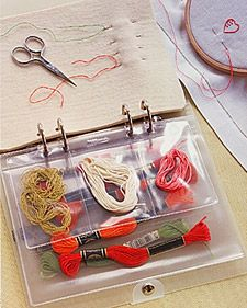 "What a good IDEA! When working on an embroidery project, you will save time if you keep the needles and threads you're using neatly sorted and separate from the rest of your sewing supplies. We filled a clear 9-inch loose-leaf binder with plastic pocket envelopes to hold various threads, small scissors, patterns, and instructions. A hole punch was used to make a ""page"" of heavy felt to hold needles."