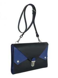 Young British Designers: Navy & Cobalt Blue Tuck Tite Satchel Bag by Kate Sheridan - It's all about the blues this new season and Kate Sheridan has created an entirely original take on the practical satchel with her super versatile Tuck Tite bag. We are big fans of the multi compartments especially when they're such a glorious cobalt blue.